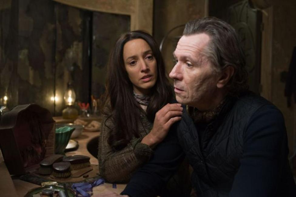 Jennifer Beals as Claudia and Gary Oldman as Carnegie in