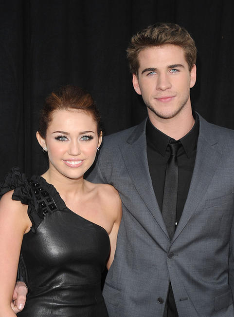 Miley Cyrus and Liam Hemsworth at the California premiere of