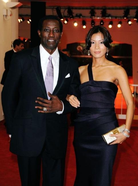 Wesley Snipes and Nikki Park at the premiere of