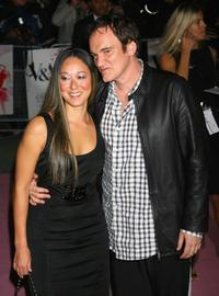 Quentin Tarantino with a guest at the Golden Age Of Couture party.
