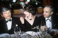 Francois Truffaut, Charlies Bronson and French actress Fanny Ardant at a dinner event in Paris.