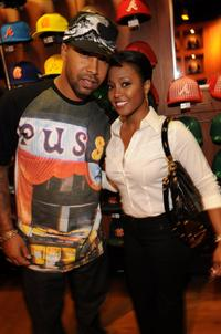 Kenny Burns and Keshia Knight Pulliam at the launch party of limited edition, custom caps.