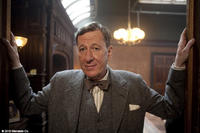 Geoffrey Rush as Lionel Logue in