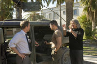 Greg Kinnear, Matt Damon and director Paul Greengrass on the set of