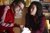 Director Peter Stebbings and Sandra Oh on the set of