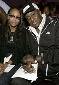 Bill Duke and Michele Revere at the Zang Toi show during the Olympus Fashion Week Spring 2005 at Bryant Park.