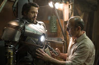 "Tony Stark (Robert Downey Jr., left) is fitted into his Mark I armor by Yinsen (Shaun Toub) in ""Iron Man."""