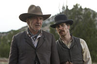 Harrison Ford as Colonel Dolarhyde and Sam Rockwel as Doc in