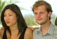 Mai Anh Le and Nicolas Duvauchelle pose at the photocall of