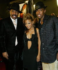 Steve Harvey, Christina Milian and Nick Cannon at the premiere of