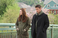 Jaime King as Sarah Palmer and Jensen Ackles as Tom Hanniger in