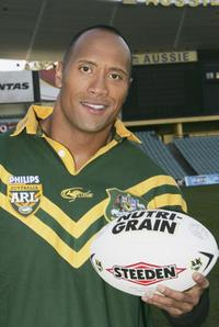 The Rock receives the Australian Rugby League official