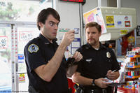Two clueless cops, Officer Slater (Bill Hader) and Officer Michaels (Seth Rogen) in