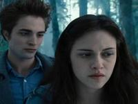 Robert Pattinson as Edward Cullen and Kristen Stewart as Bella Swan in