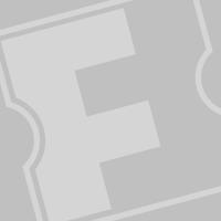 Linda Hamilton and James Cameron celebrates at the Titanic party.