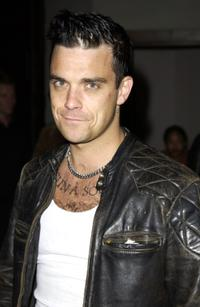 Robbie Williams at the party in celebration of Recording artist Lil Kims cover of Nylon magazines summer issue.
