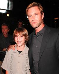 Chase Ellison and Aaron Eckhart at the premiere of