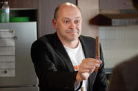 Rob Corddry as Warren in