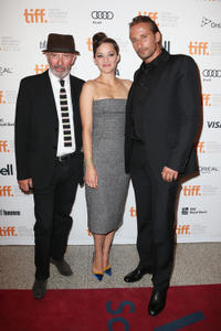 Writer/director Jacques Audiard, Marion Cotillard and Matthias Schoenaerts at the premiere of