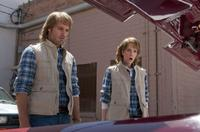 Will Forte as MacGruber and Kristen Wiig as Vicki St. Elmo in