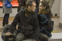 Jude Law as Remy and Alice Braga as Beth in