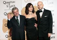 Giancarlo Giannini, Olga Kurylenko and Director Marc Forster at the premiere of