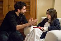 Director Jaume Collet-Serra and Isabelle Fuhrman on the set of