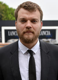 Pilou Asbaek at the Lancia Cafe during the day 6 of 69th Venice Film Festival in Italy.