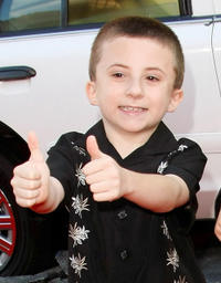 Atticus Shaffer at the premiere of