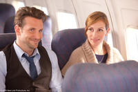 Bradley Cooper as Holden and Julia Roberts as Kate in