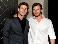 Liam Hemsworth and Chris Hemsworth at the after party for the California premiere of