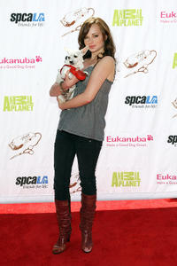 Ashley Rickards at the opening party of Artist Knox Luxury Grooming Pet Salon in California.