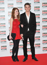 Jeremy Irvine and Guest at the Jameson Empire Awards 2011 in London.