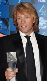 Jon Bon Jovi poses with his inductee trophy in the Awards room at the UK Music Hall Of Fame.
