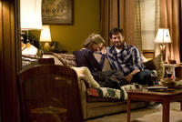 Renee Zellweger as Lucy Hill and Harry Connick Jr. as Ted Mitchell in