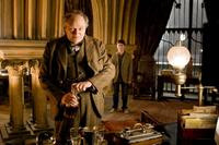 Jim Broadbent as Horace Slughorn and Daniel Radcliffe as Harry Potter in