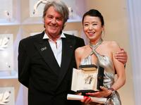 Alain Delon and Do-Yeon Jeon at the 60th International Cannes Film Festival Palme d'Or Award Ceremony.