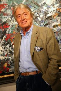 Alain Delon at cocktail party for his upcoming auction of paintings.