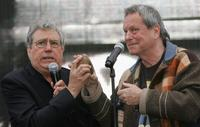 Terry Jones and Terry Gilliam at the general public in the attempt to break the Guinness World Record for the Worlds Largest Coconut Orchestra to celebrate St Georges Day.
