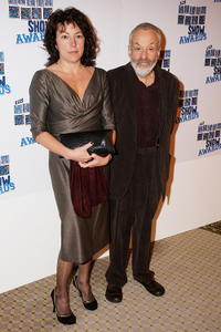 Mike Leigh and Guest at the South Bank Show Awards.