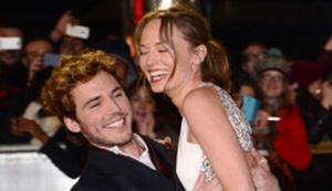 Snapshot: Jennifer Lawrence, Josh Hutcherson, Liam Hemsworth on 'Catching Fire' U.K. Premiere Red Carpet