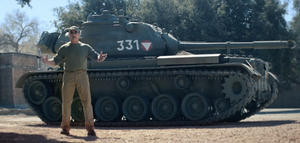 Watch Arnold Schwarzenegger Crush Stuff with a Tank