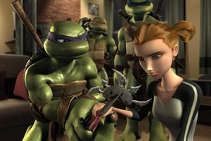 "Donatello shows April the Obsidian disc as Michelangelo and Leonardo look on in ""Teenage Mutant Ninja Turtles."""