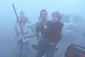 "Laurie Holden, Thomas Jane, Nathan Gamble in ""The Mist."""