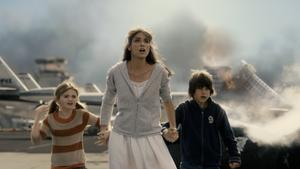 "Morgan Lily, Amanda Peet and Liam James in ""2012."""