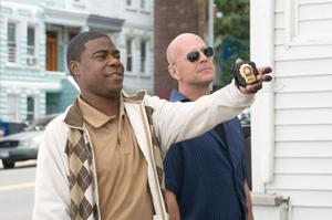 "Tracy Morgan as Paul and Bruce Willis as Jimmy in ""Cop Out."""