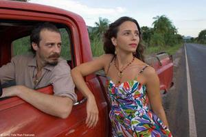 "Fele Martinez as Marco and Mariana Loureiro as Carmo in ""Carmo, Hit the Road."""