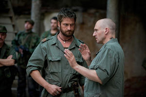 "Gerard Butler as Tullus Aufidius and Ralph Fiennes as Caius Martius in ""Coriolanus."""