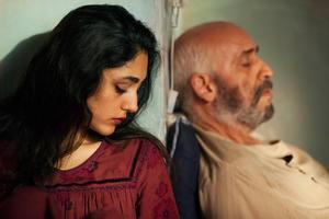 "Golshifteh Farahani as the Woman and Hamidreza Javdan as the Man in ""The Patience Stone."""