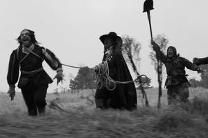 """Reece Shearsmith, Michael Smiley, and Richard Glover in """"A Field in England."""""""